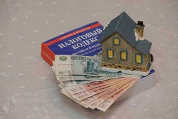 Многодетные семьи освободят от налога на 6 соток
